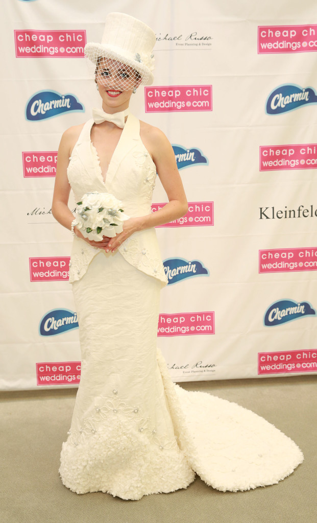 For the first time, the winning wedding dress design, shown here at the 11th Annual Toilet Paper Wedding Dress Contest presented by Cheap Chic Weddings and Charmin, will be turned into a ready-to-wear design by a Kleinfeld Bridal designer, on Wednesday, June 17, 2015 in New York. (Amy Sussman/AP Images for Charmin)