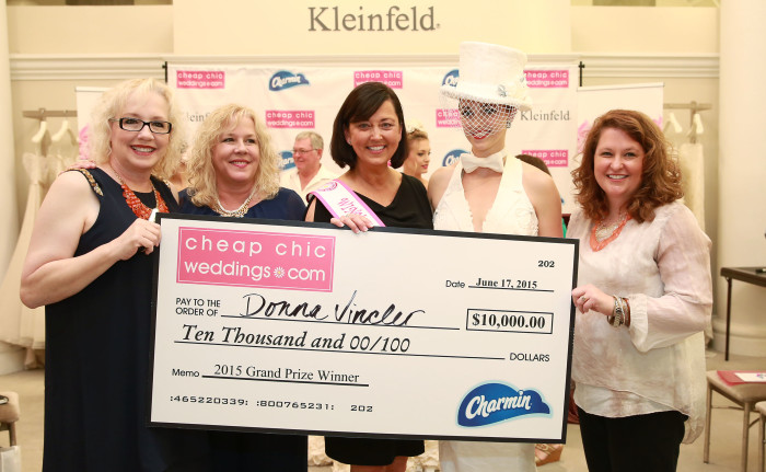 (L-R) Susan Bain and Laura Gawne from Cheap Chic Wedding, the winner of the 11th Annual Toilet Paper Wedding Dress Contest, Donna Pope Vincler, her daughter Aubrey Swander and Velvet Gogol Bennett from Charmin pose with the $10,000 grand prize on behalf of Charmin on Wednesday, June 17, 2015 in New York. Her gown was exclusively made of Charmin toilet paper, glue and thread. (Amy Sussman/AP Images for Charmin)